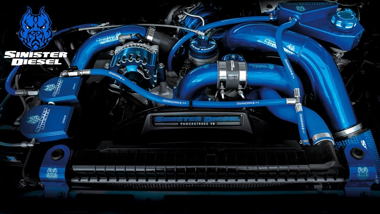 engine decked out with sinister diesel parts on it everywhere